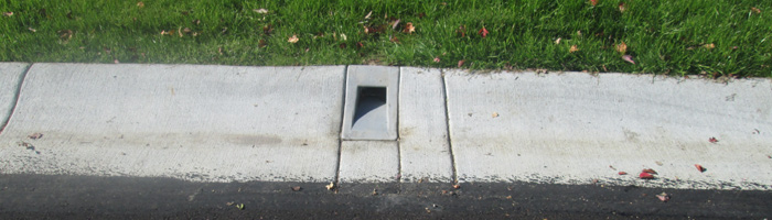 Installed Curb Drain, Installed J Drain, Thru The Curb Drain